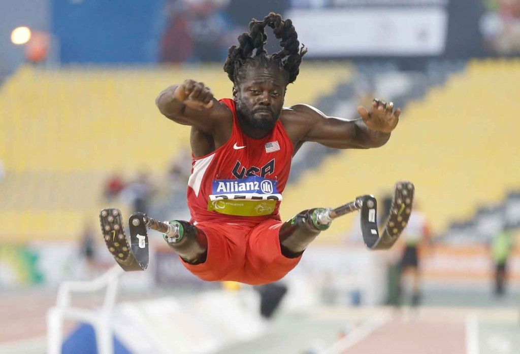 Regas Woods of the United States competes in the men's long jump T42 final during the Evening Session on Day Five of the IPC Athletics World Championships