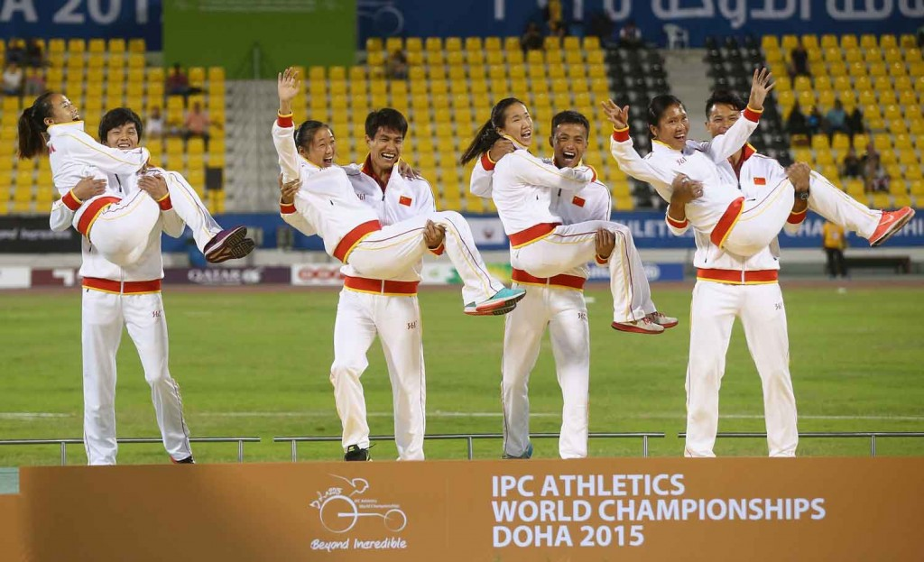 China celebrate winning gold medals in the women's 4x100m T11-13 final